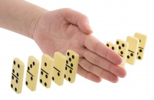Bones of dominoes and hand