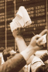 Stock brokers with arms in the air
